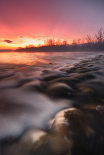 Izlazak sunca nad rijekom